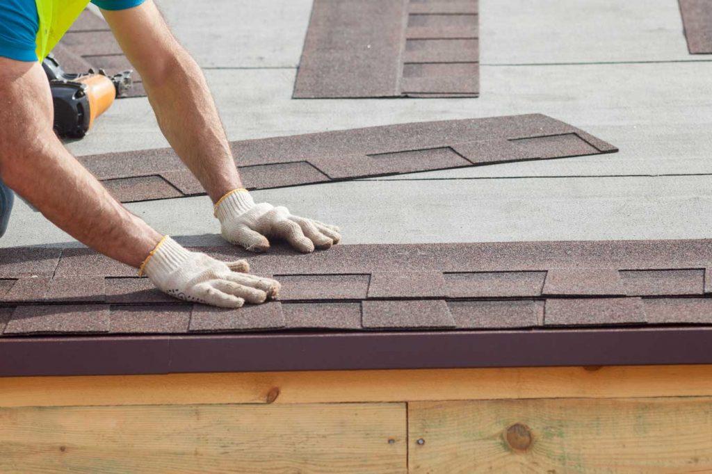 Roofer Builder Worker Installing Roof Shingles